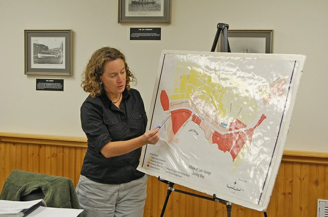 Lisa Nagle of Elan Planning, Design and Landscape Architecture holds map of Lake George village during the village's Lake George Steering Committee meeting on Oct. 23.