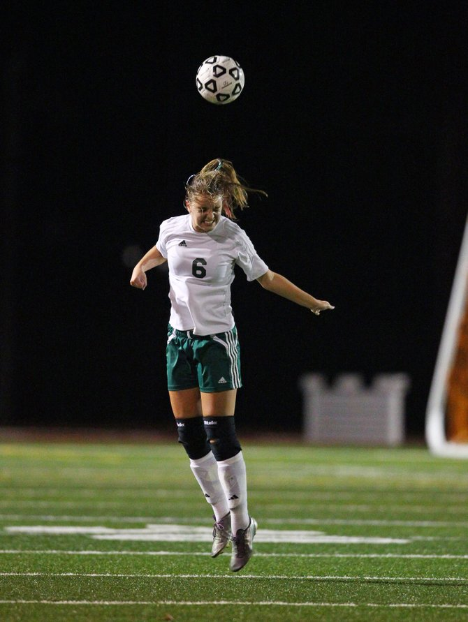 Fayetteville-Manlius midfielder Jessica Puro (6) attempts a header in Thursday night's Section III Class AA quarterfinal against CBA. The Hornets went on to beat the Brothers 3-1.