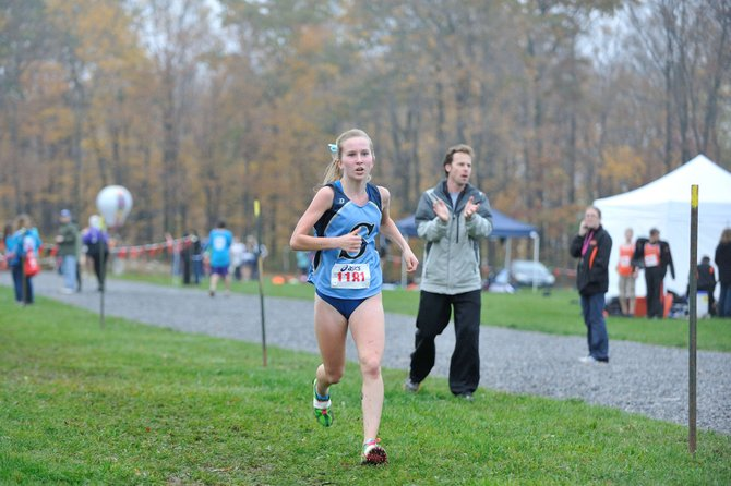 Skaneateles girls cross country freshman Kaitlyn Neal, cheered on by her father, comes home in first place in Wednesday's OHSL Liberty division championship meet at Jamesville Beach Park. Neal finished in a time of 19 minutes, 15.6 seconds.