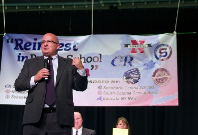 South Colonie Board of Education President Leonard Motto delivers closing remarks during a forum on Thursday, Oct. 18, at Sand Creek Middle School, with area five school districts protesting state funding reductions to education.