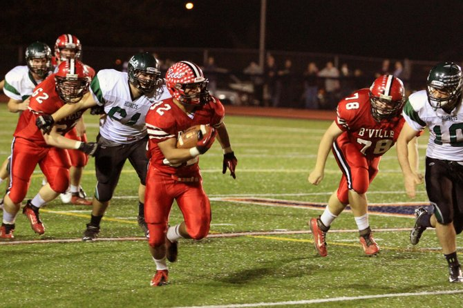Baldwinsville running back Tyler Rouse (32) breaks free again for a long run in Friday night's Class AA quarterfinal against Fayetteville-Manlius. Rouse ran for 272 yards on 35 carries, scoring four touchdowns, as the Bees held off the Hornets 38-36.