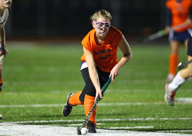 Liverpool field hockey forward Shelby Peck (22) charges up the field in Sunday night's Class A semifinal against Fayetteville-Manlius. Peck scored both of her team's goal, including the game-winner in overtime, to send the Warriors past the Hornets 2-1.