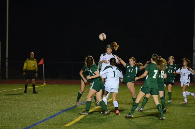 Numerous Bishop Ludden defenders surround Marcellus senior Brielle Filtch (7) as she takes a header in last Thursday's Class B quarterfinal. Filtch had two goals in the Mustangs' 3-0 victory over the Gaelic Knights.