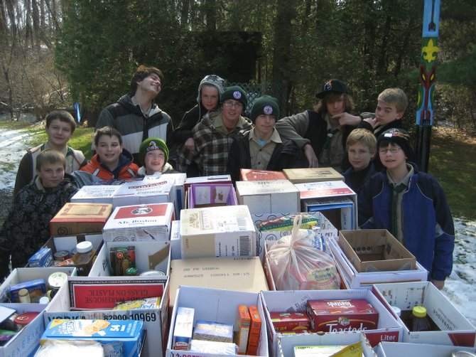 Cazenovia Scouts surround collected food before delivery to CazCares in 2011. This year, the Scouts will again participate in Scouting's National Good Turn, Scouting for Food, where they will collect items and donate them to CazCares.