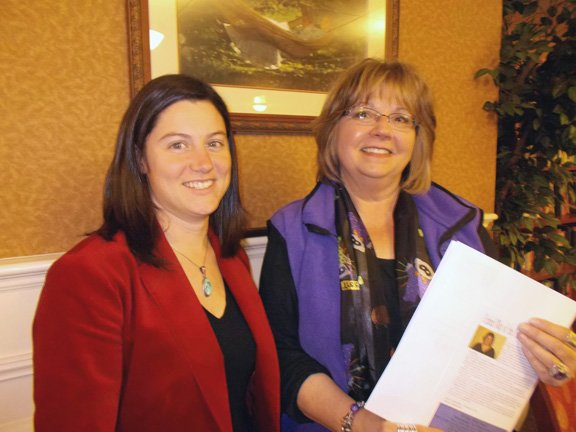 Maria Burke, left, director of Literacy Volunteers, and Barb Brassard, director of the Retired Senior Volunteer Program, review United Way information following a meeting in Ticonderoga.