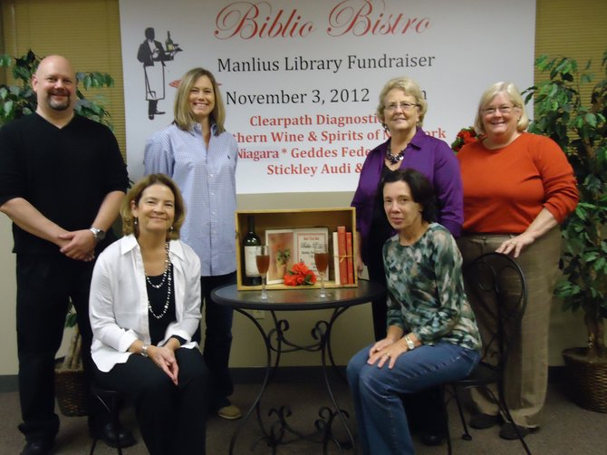 Some of Manlius Library's Biblio Bistro planning committee meet to finalize details of the Nov. 3 fundraising event. Pictured from left are deputy director David D'Ambrosio, Amy Currier, Tracy Burbine, Lynette Jozefczyk (in front), Mary Veeder-Civitello and program coordinator Trish Paparone.