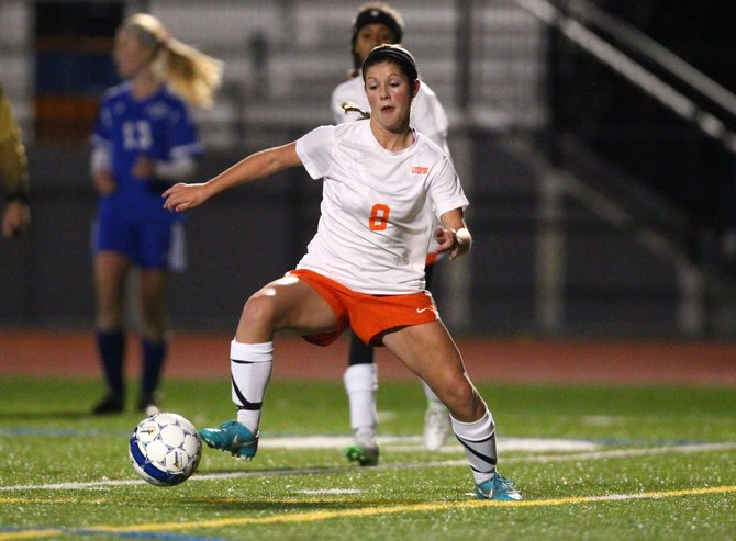Liverpool junior midfielder Emma Geyer (8) settles the ball and looks up the field during Tuesday night's Class AA semifinal against Cicero-North Syracuse. The Warriors beat the Northstars 1-0 and advanced to the championship game against Fayetteville-Manlius.