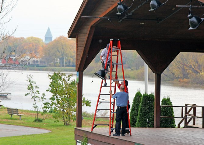 Volunteers move equipment from the stage at Freedom Park in Scotia on Saturday, Oct. 27, and make final preparations before Hurricane Sandy struck on Monday, Oct. 29.