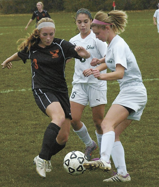 Bethlehems Elle Lutz, left, battles two Shenendehowa players for the ball during Sundays Section II Class AA quarterfinal game in Clifton Park. The Lady Eagles advanced with a 1-0 win.