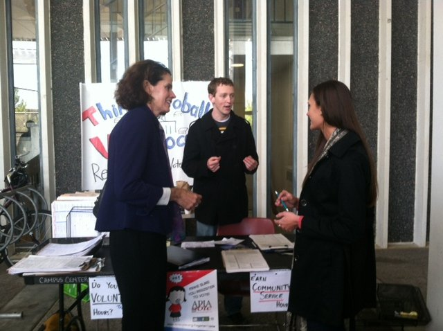 """Think Globally, Vote Locally"" UAlbany organizers Martha Mahoney and Kevin Fox speaking with 109 Assembly District  Democratic candidate Patricia Fahy at a campus event in October."