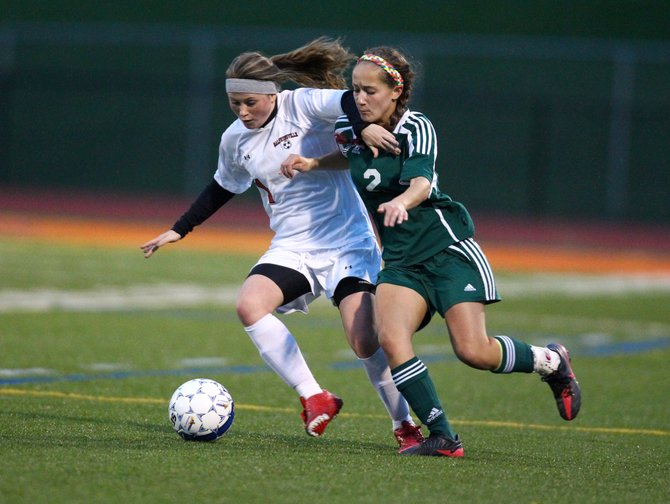 Baldwinsville senior forward Cassidy Bruen (1) battles for the ball with Fayetteville-Manlius' Alexa Restante (2) in last Tuesday night's Class AA semifinal. Though Bruen converted a penalty kick in the decisive shoot-out after a 1-1 draw, the Bees still fell to the Hornets.
