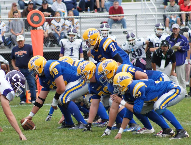 The Cazenovia varsity football offensive line prepares for an upcoming play. The Lakers defeated the Camden Blue Devils 54-7 on Oct. 26.