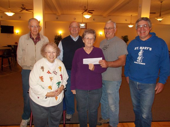 "Ticonderoga restaurant took part in the ""Wing War"" at the Knights of Columbus recently to raise money for the Ticonderoga Food Pantry. From left are John Williams, a pantry volunteer; Emma Williams, a pantry volunteer, John Bartlett; Margaret Beuerlein, pantry director; Rollin Slattery, grand knight; and John Blanchard, Knight's treasurer."