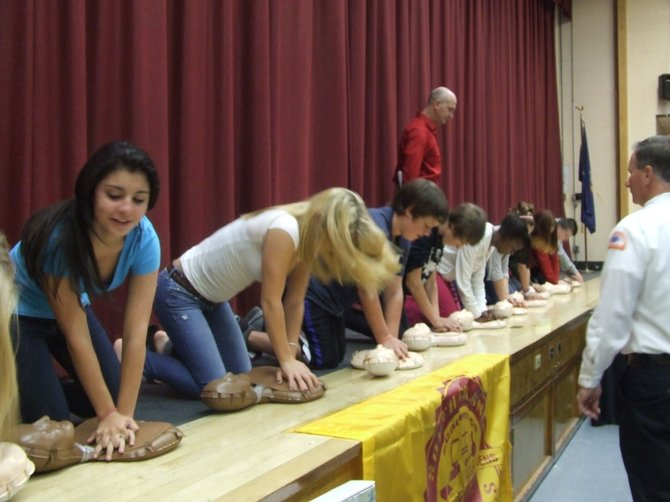 Sand Creek Middle School students learn how to use hands-only CPR kits, donated by First Niagara.