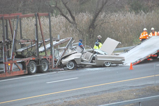 State Police said this 1961 Chevrolet slammed into the back of a car carrier that was pulled over on the Thruway. The driver was seriously injured.