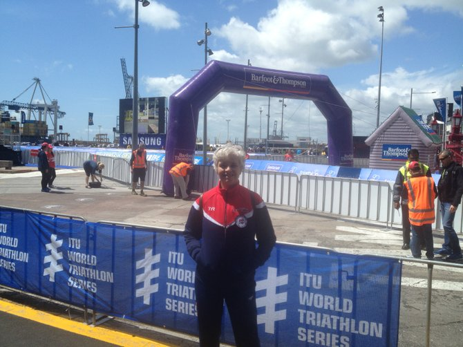 Chary Griffin poses in front of the starting line for the ITU World Championship in Auckland, New Zealand.