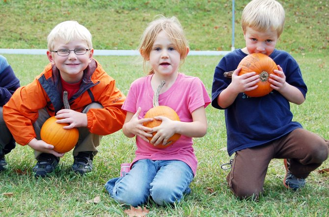 William Hance, Casey Valentin, Henry Gibson pose with their pumpkins after the pumpkin picking at Westport Central School on Oct. 26. 
