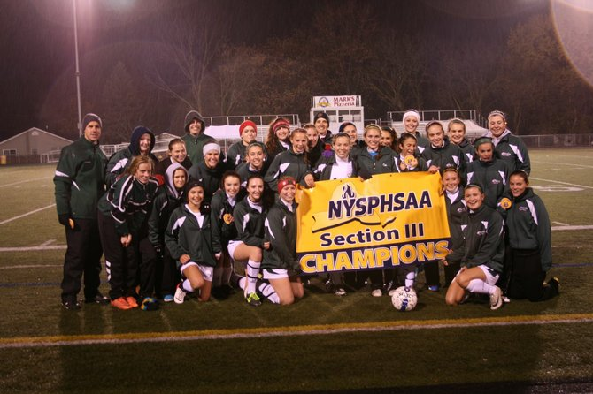 The Marcellus girls soccer team receives the Section III Class B championship banner after beating Clinton 2-1 in overtime in Friday night's title game at Chittenango High School. It's the seventh sectional title the Mustangs have won or shared seven of the last 10 sectional titles.