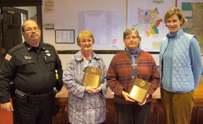 Cazenovia Chief of Police Michael Hayes, left, stands beside crossing guards Muriel Stevens and Suzann Davies and Deputy Mayor Amy Mann, as the two women are presented their honorary plaques for their service to the village of Cazenovia on Tuesday, Oct. 30 in the Municipal Building.