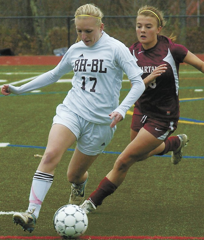 Burnt Hills-Ballston Lake's Carly Finn (17) and Scotia-Glenville's Ceci Hyland battle for the ball during Saturday's Section II Class A championship game at Stillwater High School.