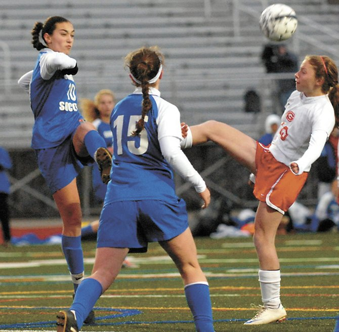 Guilderland's Jessica Capone, right, battles Shaker's Jean Mary Chakmakas, left, for the ball during Saturday's Section II Class AA semifinal game at Schuylerville High School.