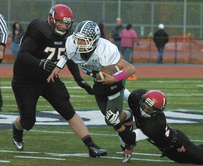Schalmont quarterback Nick Gallo is tackled by a Glens Falls defender during the second quarter of Saturday&#39;s Section II Class B championship game at Shenendehowa High School.