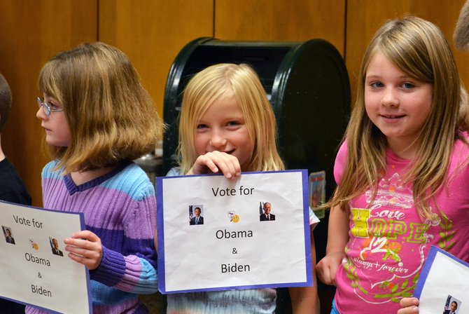 Students (left to right) Lilly Schultz, Rosa Stasyuk and Kiley Kimpel pose as Obama supporters as part of the school's mock election.
