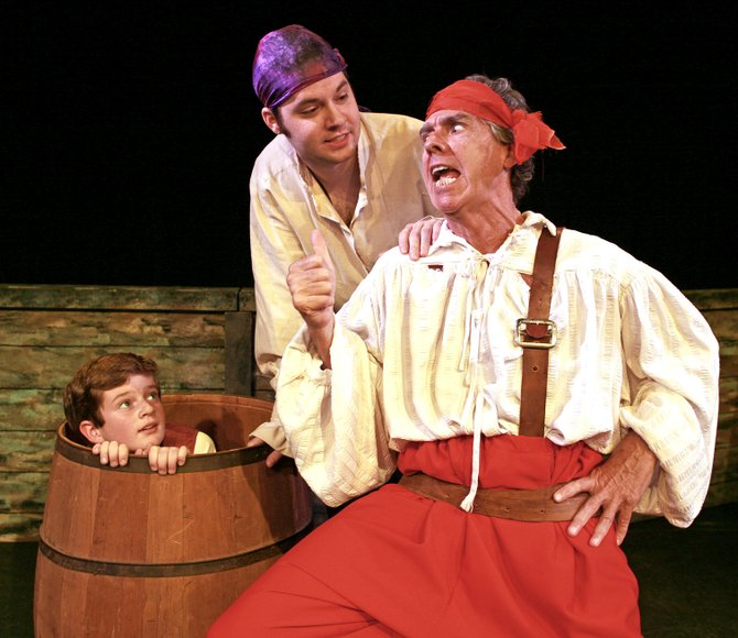 Jim Hawkins, played by Miles Keefe, is hidden in the apple barrel when he overhears a mutinous plot by the pirates.