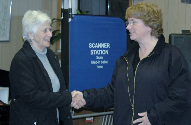 Evelyn Hatch shakes hands with Elizabethtown Supervisor Margaret Bartley after winning a seat on the town council.