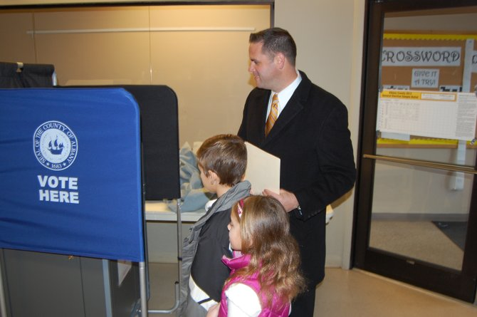 Republican candidate for Bethlehem Town Board Jeremy Martelle votes with his children on Election Day.