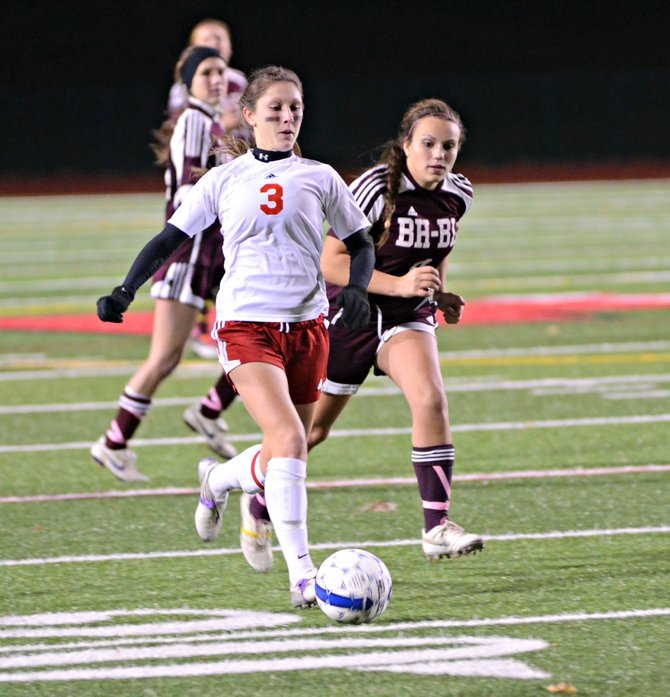 Jamesville-DeWitt senior midfielder Maddy Devereaux (3) clears the ball out of her own end in Tuesday night's Class A regional game against Burnt Hills-Ballston Lake. The Red Rams won, 1-0, avenging three straight regional defeats to the Spartans.