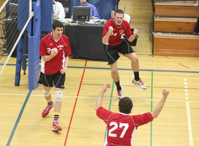 Baldwinsville boys volleyball front-line players Anthony DeMarco (27), Grady Schmidt (28) and Shawn Calnan (24) celebrates a point versus Oswego during the Section III class AA final. The trio combined for 29 kills as the Bees beat the Buccaneers in four sets.