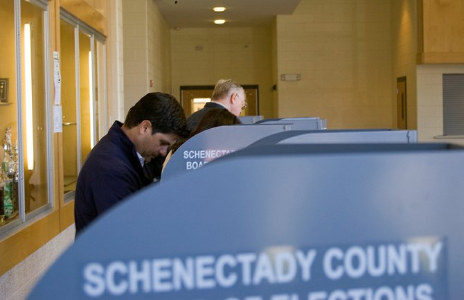 Republican George Amedore casts his ballot at Schalmont High School on Election Day. Amedore's bid for the newly drawn 46th Senate District against Democrat Cecilia Tkaczyk didn't have a clear winner after unofficial election results on Tuesday, Nov. 6.