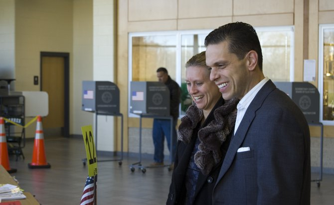 Angelo Santabarbara casts his vote alongside his wife, Jennifer, at Schalmont High School on election day. Santabarbara defeated Thomas Quackenbush for the newly redrawn 111th Assembly District.