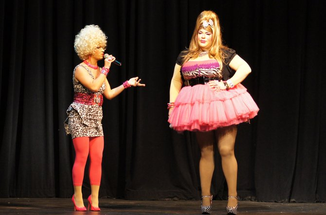 """Cazenovia native Travis Barr, right, portrays Anita M. Buffem on stage with fellow actor Steven Incammicia, as Gina Marie Rittale, during """"The Showgirls Strike Back!"""" on Oct. 27 in the Catherine Cummings Theater."""