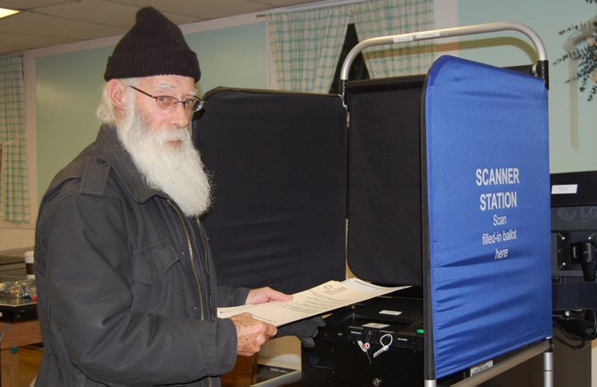 Roger Adams of Westport casts his vote on Nov. 6 for the candidates of his choice. Adams was one of the first to vote at the Westport polling site.