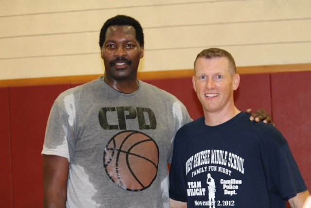 WGMS principal Stephen Dunham, right, and SU basketball legend Roosevelt Bouie pose for a photo after an intense game.