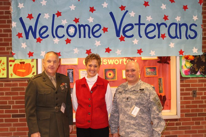Marine Corps Major Steve Carey (left) stands with fourth grade teacher Kate Smith and Army First Sergeant Ray Swift.