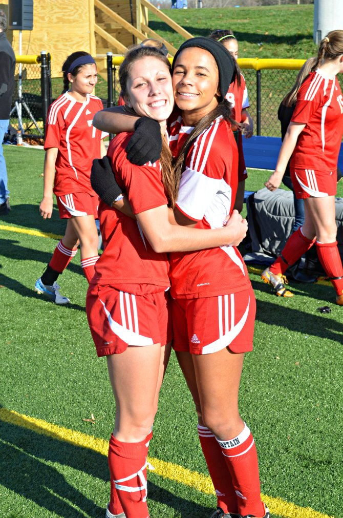Jamesville-DeWitt girls soccer teammates Maddy Devereaux, left, and Jessica Holmes celebrate Saturday's 2-1 victory over Massena in the Class A regional final. Devereaux and Holmes, part of all four of J-D's sectional championship teams, scored the goals in the second half that sent the Red Rams to its first-ever state final four.