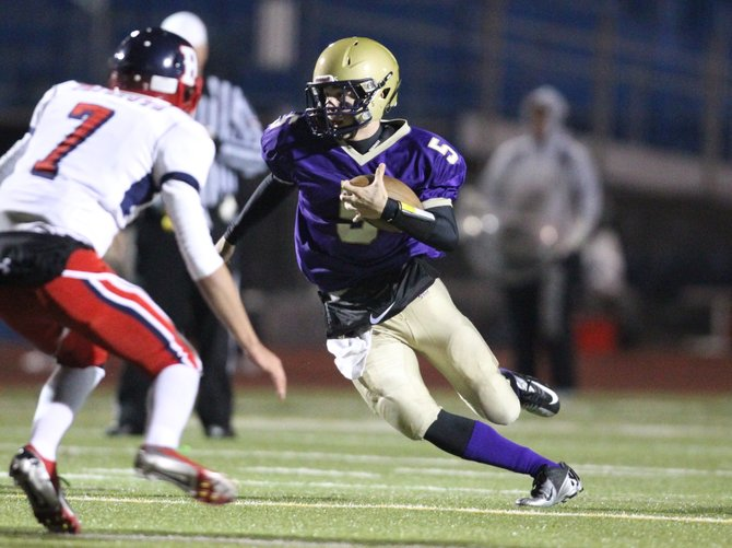 CBA quarterback J.R. Zazzara (5) heads out of the pocket and scrambles in Saturday night's Class AA regional final against Binghamton. Zazzara threw for 212 yards and ran for 55 more in the Brothers' 31-7 victory over the Patriots.