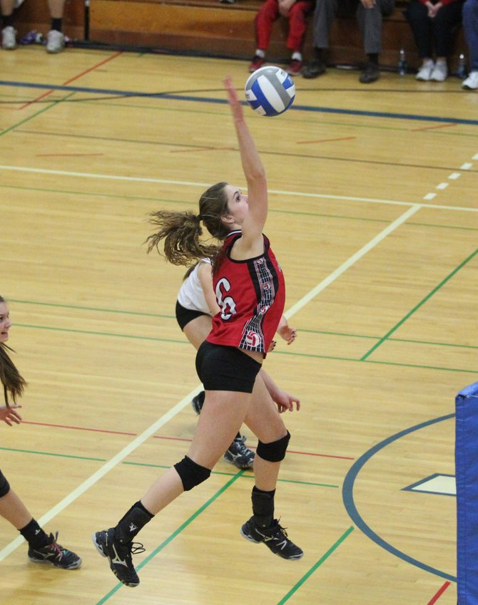 Baldwinsville junior middle hitter Amanda May (6) puts all of her power into a spike attempt in last Wednesday night's Class AA final against Fayetteville-Manlius. May and the Bees swept the Hornets, and went on to sweep Shenendehowa Saturday to earn a return trip to this weekend's state tournament in Glens Falls.