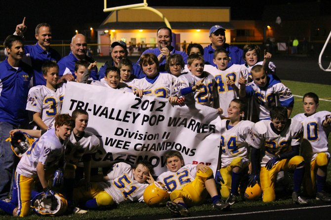 The Cazenovia Pop Warner B-Team coaches and players celebrate after being crowned Tri-Valley League Pee-Wee Division Champions last month.