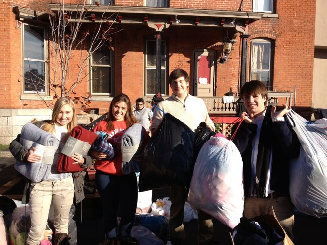Manlius Pebble Hill students recently collected urgently needed items for victims of Hurricane Sandy. Necessities were delivered to Laci's Tapas Bar, the Syracuse restaurant whose owners are traveling to the New York City/New Jersey area with supplies. Shown making one of many deliveries to Laci's are (from left) MPH seniors Jessie Glies, Christy Murphy and Jordan Olinsky, and 2012 MPH graduate James Gavigan, now a student at SUNY Geneseo.