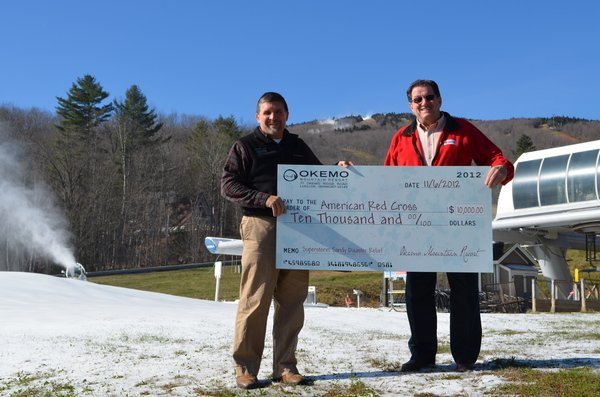 Okemo Mountain Resort VP and General Manager Bruce Schmidt presents check for $10,000 to American Red Cross Deputy Chief Response Officer Bruce Pollock for Superstorm Sandy relief efforts.
