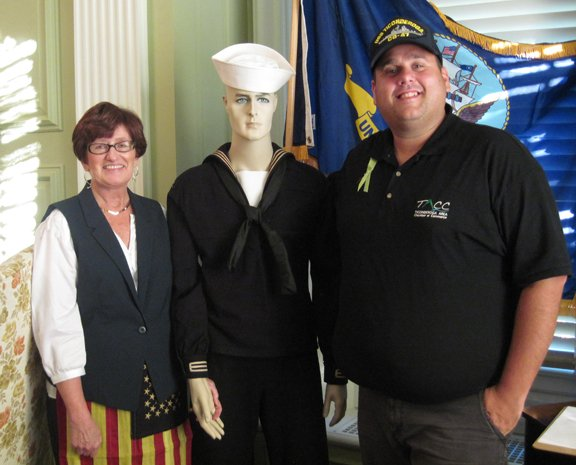 "June Curtis of the Ticonderoga Historical Society and Matthew Courtright, executive director of the Ticonderoga Area Chamber of Commerce, poses with an exhibit during the annual ""Night at the Museum"" at the Hancock House."