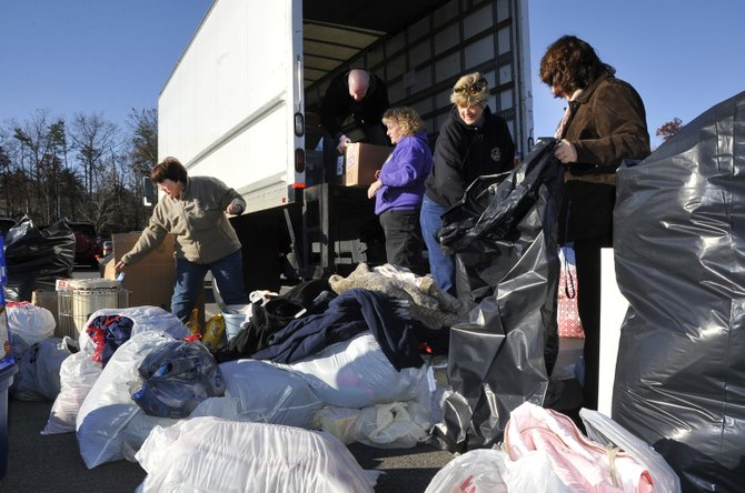 Community members and residents contribute donations for those affected downstate by Superstorm Sandy.
