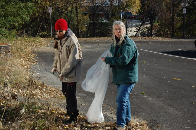 Jeanette Rasmussen and her daughter, Olya May, picking up trash in Plattsburgh for People For Positive Action.