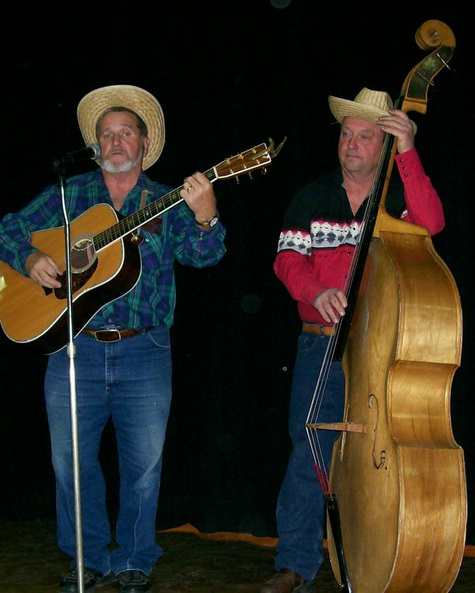 Hoddy Ovitt and Jim Davis perform crowd favorites during a recent year's concert to benefit Operation Santa Claus. This year's event, an informal sing-along, is set for 7 p.m. Friday Nov. 16.