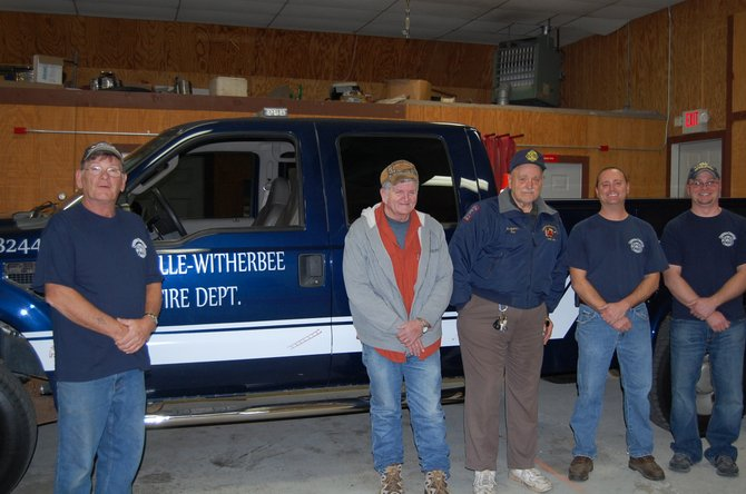 Department safety officer John Santose, Department Chairman Charlie Farnsworth, Fire commissioner Ron Haseltine, Second Assist. Fire Chief Ray Briggs, and FD chief Adam Wright stand before the departments new brush truck.