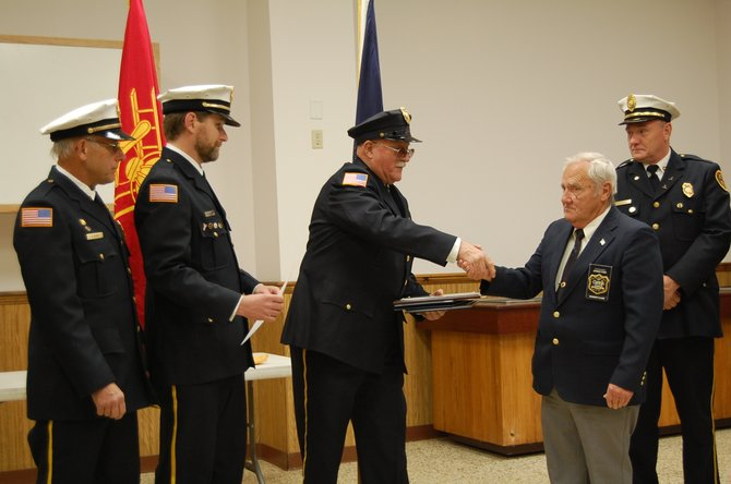 Fire department officers Bill Trybendis, president of FD commissions, George Harrington, FD treasurer, Brian Glebus, FD Chief, Ed Roberts assistant FD chief, and first assistant chief Dave Decker and Deputy Fire Coordinator Herb Clark present William Wykes with three awards and certificates on Nov. 15 for 53 years of service to Moriah FD.